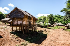 Village food storage sheds, made of bamboo and thatch, are traditionally built on stilts to withstand flooding. Monk Khmu village, northern Luang Prabang province. (Photo courtesy of Martin Abbiati/ Photographer)