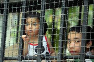 Children, part of a group of asylum seekers, sit in a truck as Thai Immigration officials escort them to a court in Songkhla province on March 15. Photo: Tuwaedaniya Meringing / AFP