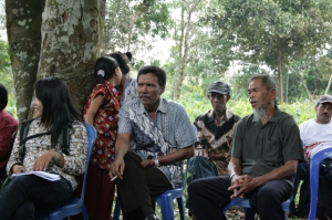 Ethnic Dayak villagers discuss encroachment by palm oil companies on their land [Gohong/ 2014/Dana MacLean/Al Jazeera]